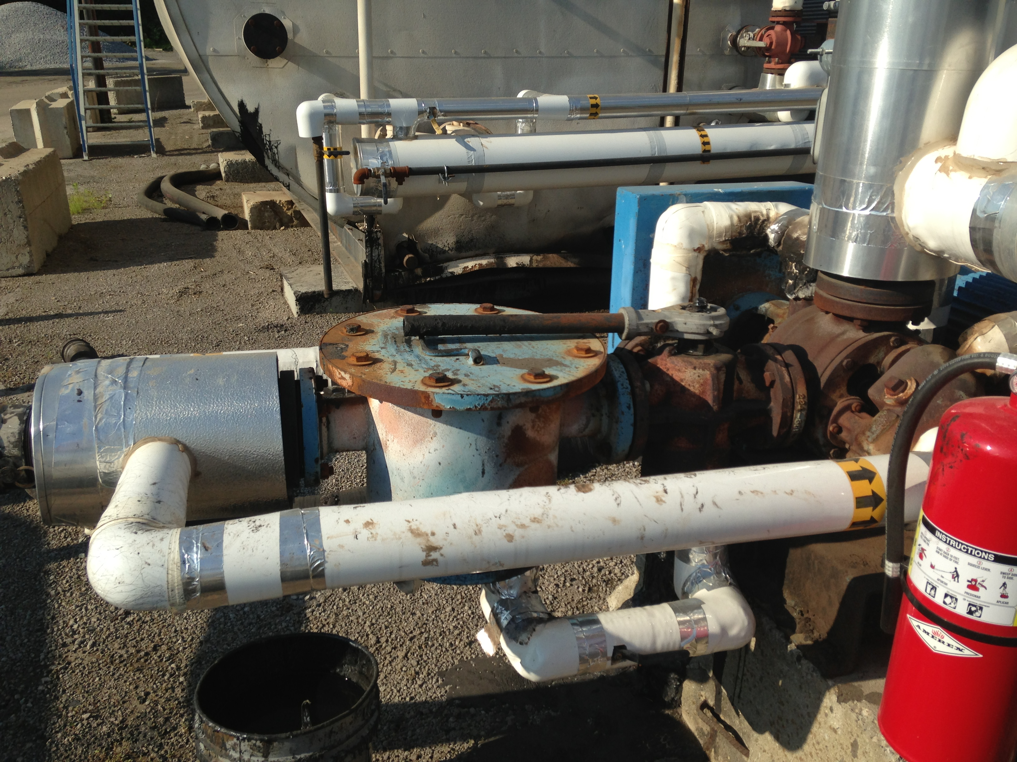Before Removable Insulation Blankets Around Pump And Filter At Asphalt Plant