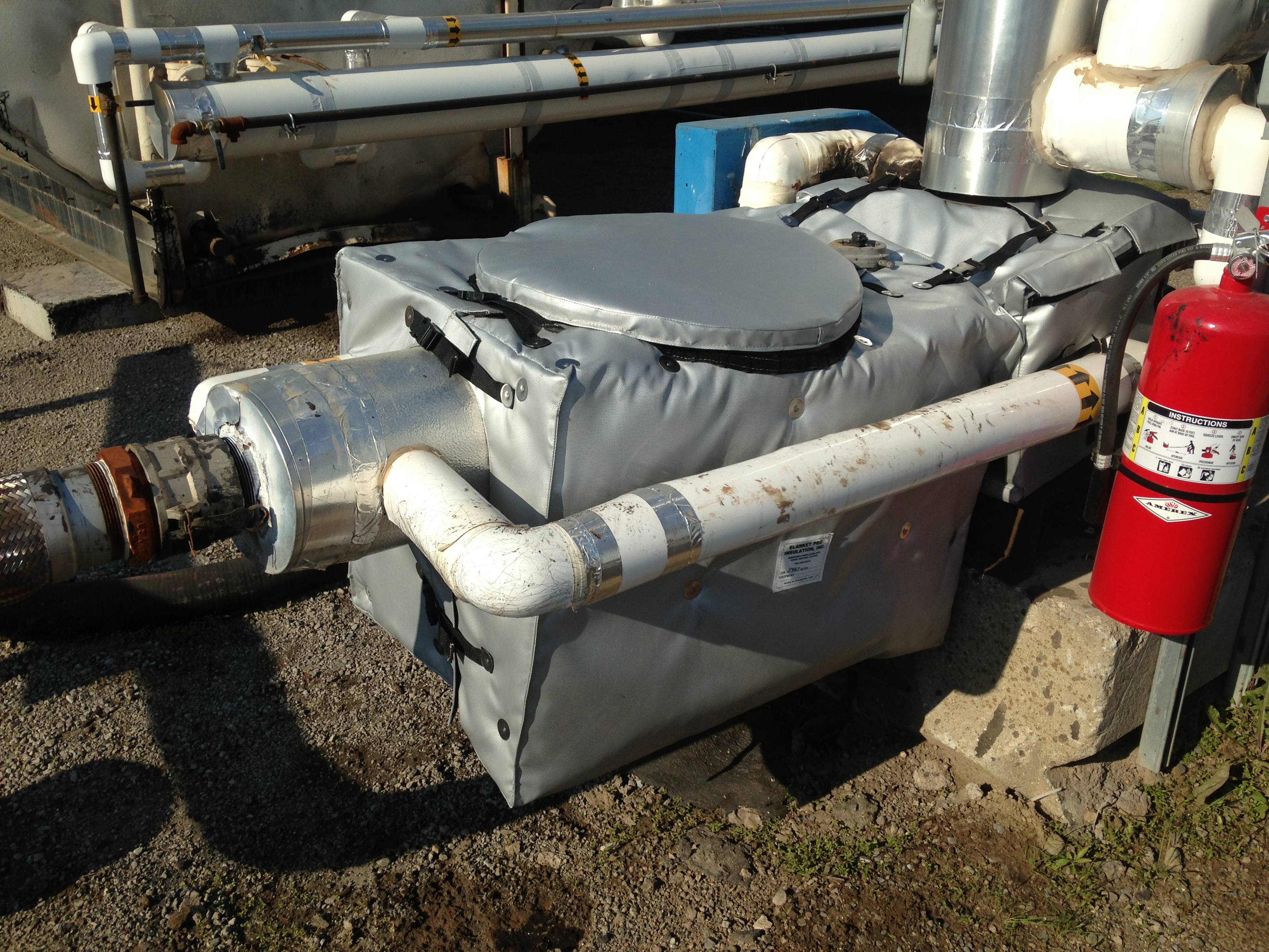 Removable Insulation Blankets Around Pump And Filter At Asphalt Plant